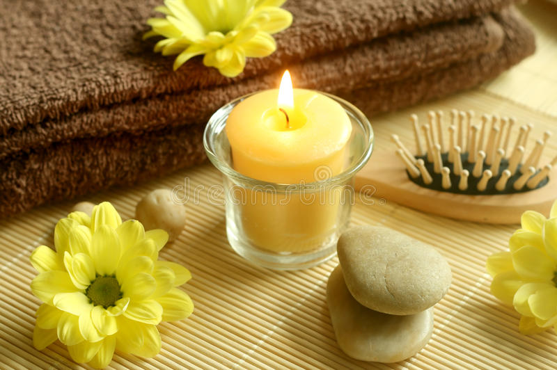 towel, flowers, stones and candle stock photos