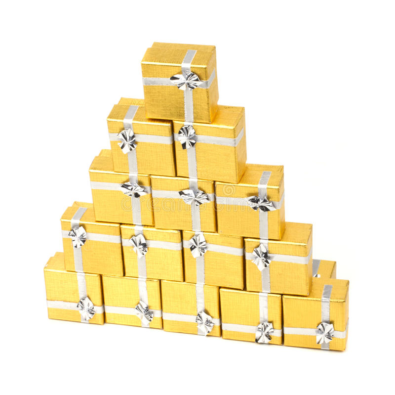 Towel gold gift boxes on white stock image