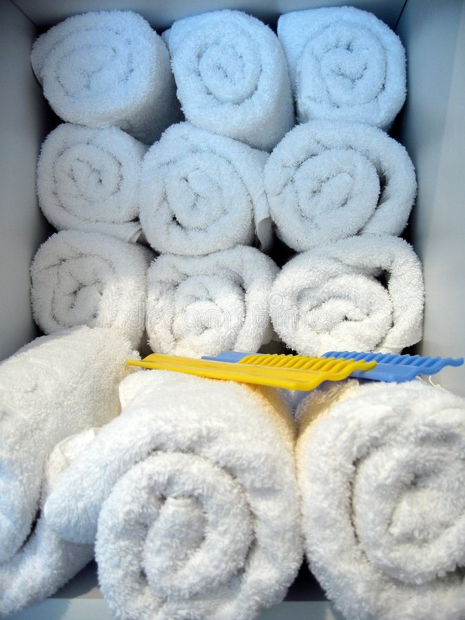Towel and hairbrush. Clean towels ,spa towels with combs royalty free stock photo