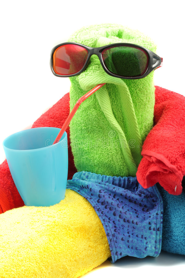 Towel man drinking. Toy towel man drinking from blue cup isolated stock photo