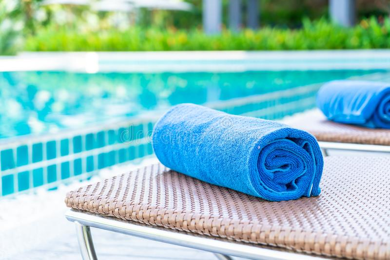 Towel pool on bed around swimming pool in hotel resort. Holiday vacation concept royalty free stock photo