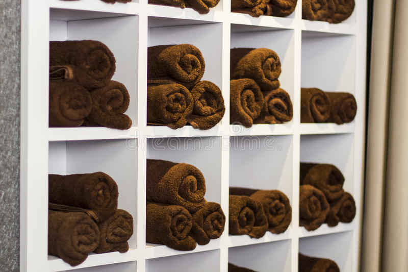 Towel rack. Towel arranged properly in the rack stock photos