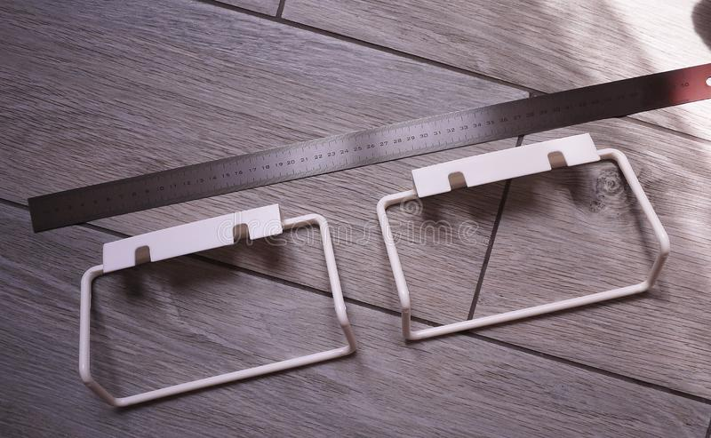 Towel rack to bathroom or kitchen. Small accessory interior bathroom or kitchen, will help in the economy. Details and closging. Towel rack to bathroom or royalty free stock photos