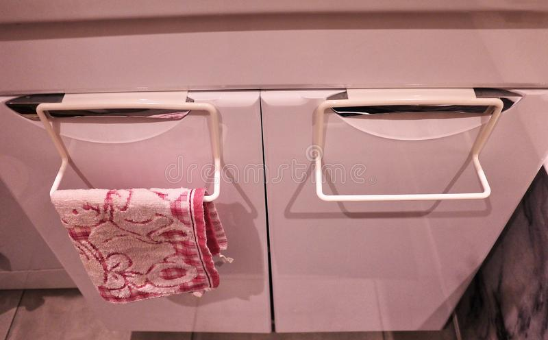 Towel rack to bathroom or kitchen. Small accessory interior bathroom or kitchen, will help in the economy. Details and closging. Towel rack to bathroom or royalty free stock photo