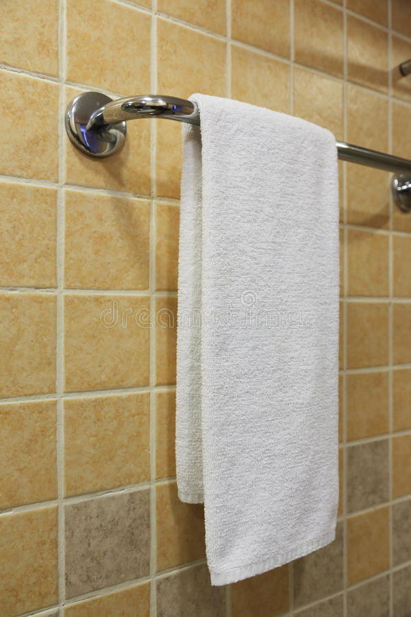 Towel on the rack. White clean towel on the rack royalty free stock photos