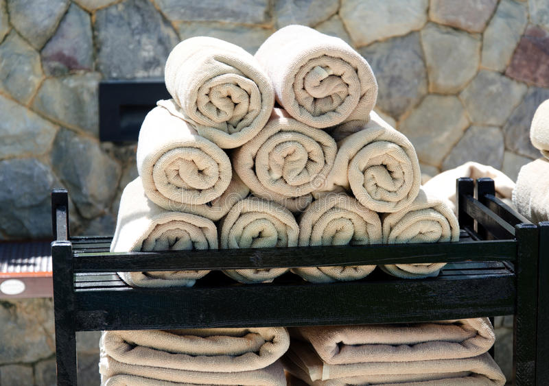 Towel. Rolled towel placed over the many stock photo