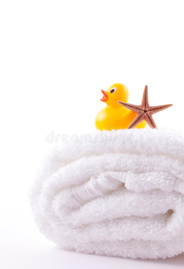 Towel and rubber duck stock image