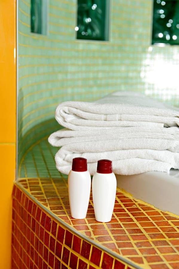 Towel, shampoo and gel in a bathroom. Shampoo and gel in a bathroom stock image