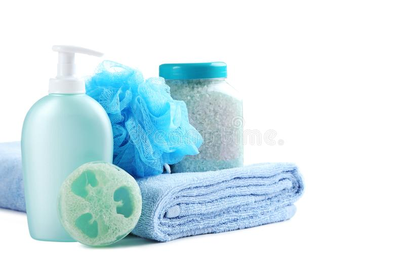 Towel with soap, wisp. And bottle on a white background royalty free stock photos
