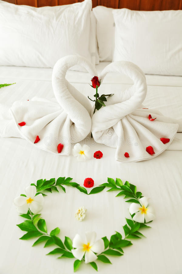 Towel Swan Heart. On the bed - special honeymoon hotel decoration stock images