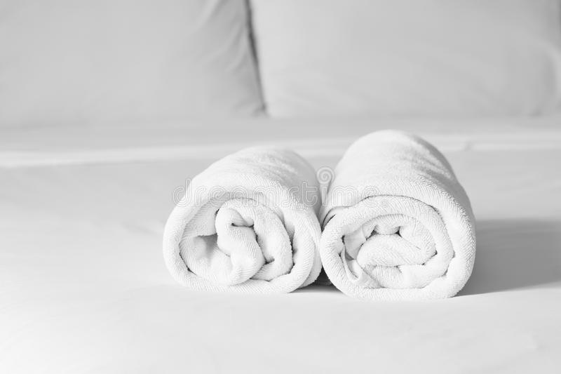 Towels on bed sheet decorative at home stay, shallow DOF. Towels on bed sheet decorative at home stay royalty free stock image