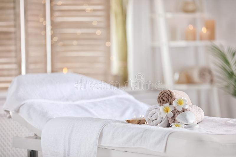 Towels and candles on massage table in spa salon. Place for relaxation stock images