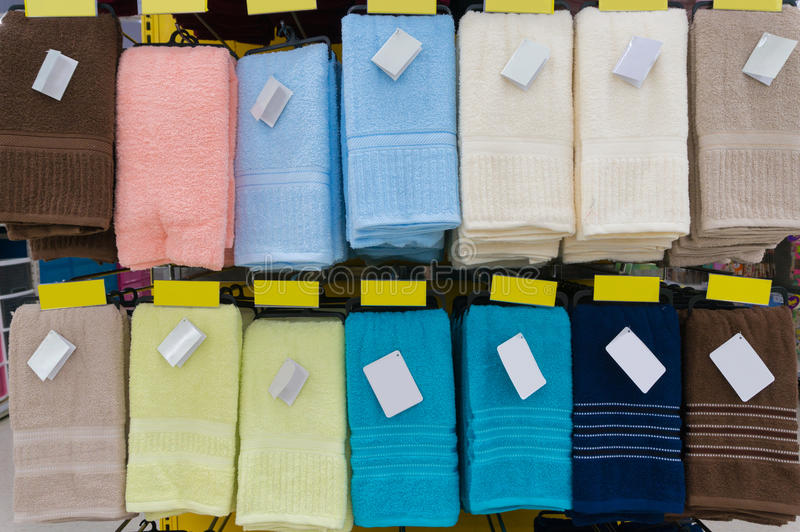 Towels Hang on Shelf in Supermarket or Hypermarket with Blank Ta. Towels Hang on Shelf in Supermarket or Hypermarket as Backround with blank Tag royalty free stock images
