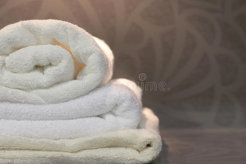 Towels in hotel bathroom. White towels in hotel bathroom royalty free stock photos