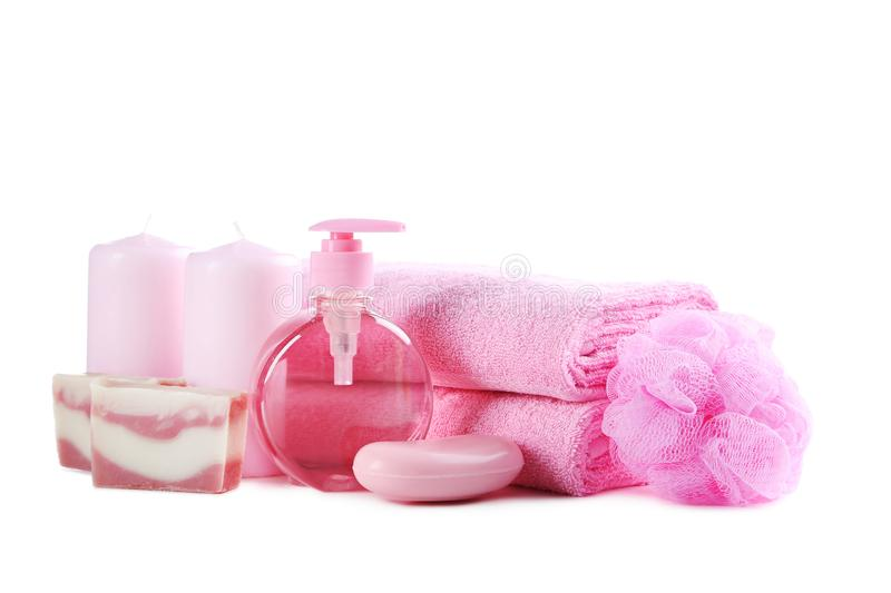 Towels with soap and wisp. Pink towels with soap and wisp isolated on a white background stock photography