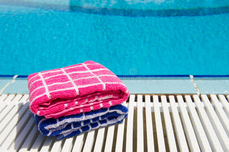Download Towels  at swimming pool stock photo. Image of pile, checked - 32873742