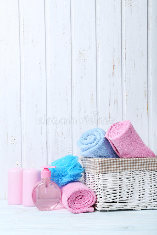 Towels with wisp. And candle on white wall paneling background stock images