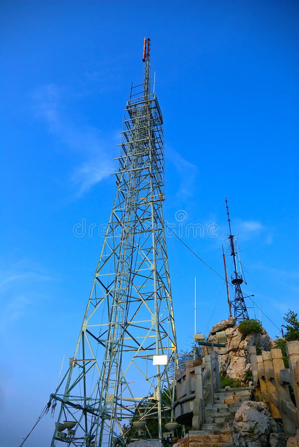 Tower. Stands at the top of the hill, the background is pure blue sky royalty free stock image