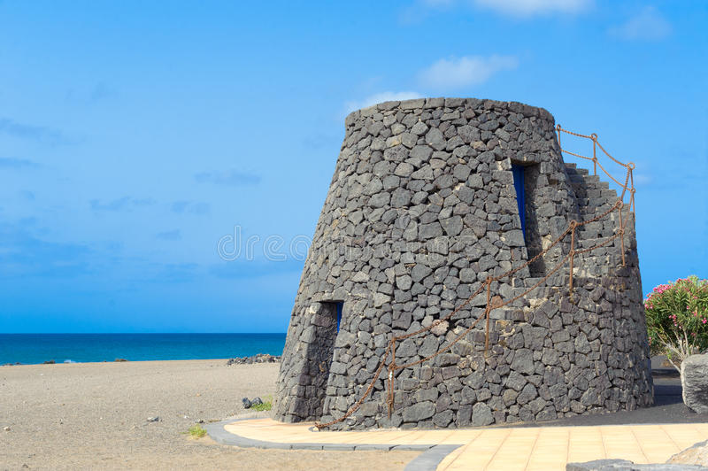 Tower. Old tower built with lava rocks stock image