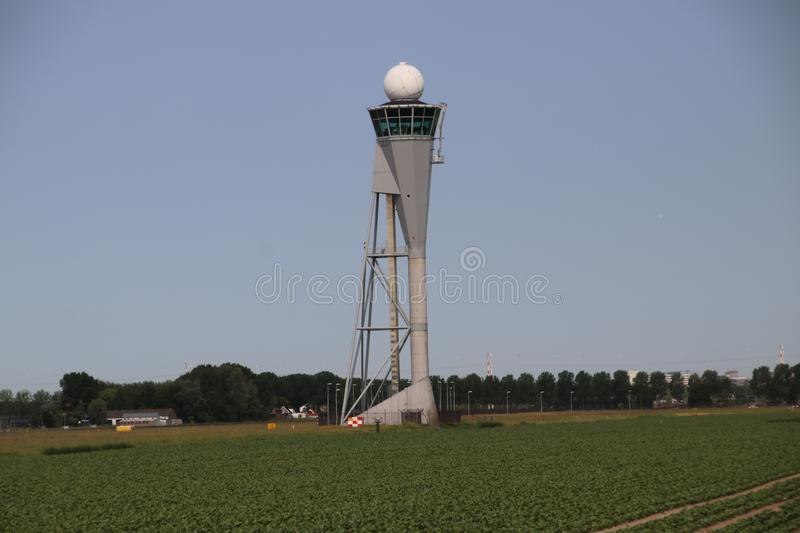 Tower for Aircraft landing at the Polderbaan 36L-18R at the Amsterdam Schiphol airport in the Netherlands. stock images