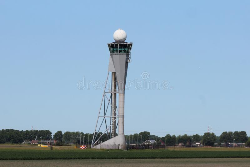 Tower for Aircraft landing at the Polderbaan 36L-18R at the Amsterdam Schiphol airport in the Netherlands. stock photography