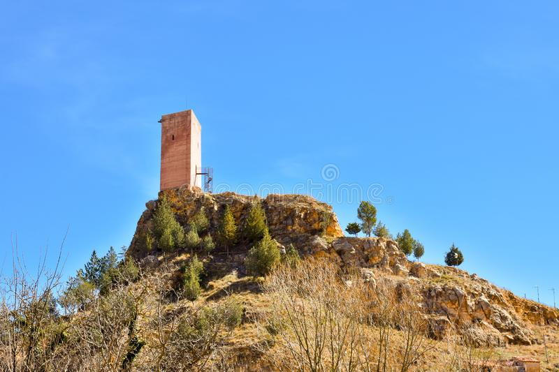 tower of a ancient castle in a small village called Villel in Teruel / Spain in a sunny clear day. The castle is ruined but the stock photography