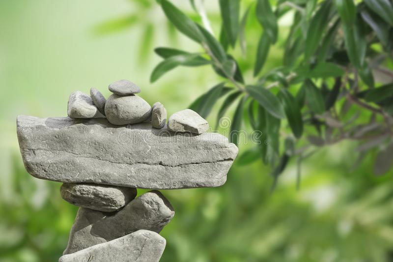 Tower of balancing stones against blurred background. Space for text stock photo