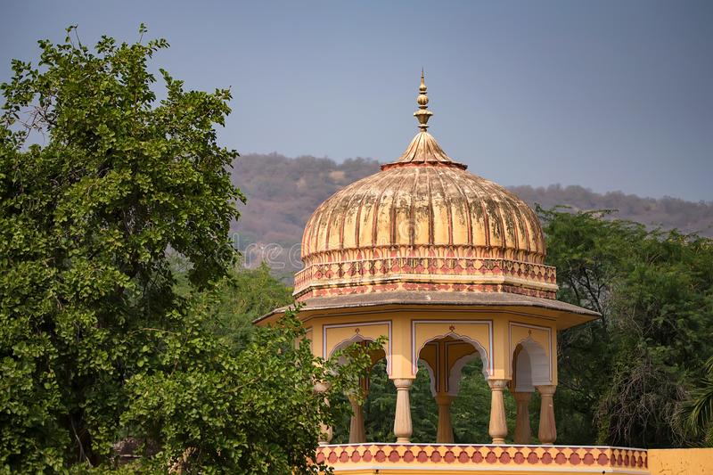 Tower of beautiful Indian style palace. View of part of white Indian palace with trees in background on sunny day royalty free stock image