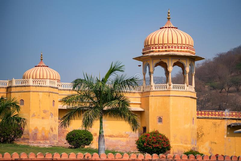 Tower of beautiful Indian style palace. View of part of white Indian palace with trees in background on sunny day stock image