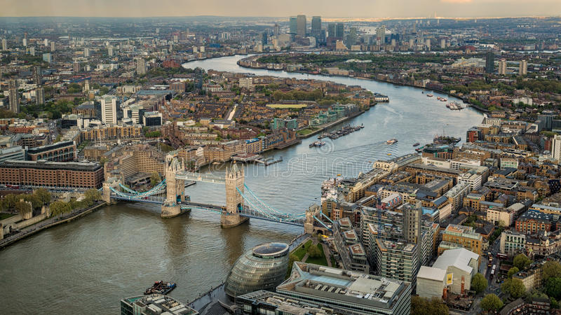 Tower Biridge with river Thames and London skyline. Overhead view of Tower Bridge and the skyline of London in England with the river Thames winding through the royalty free stock photos