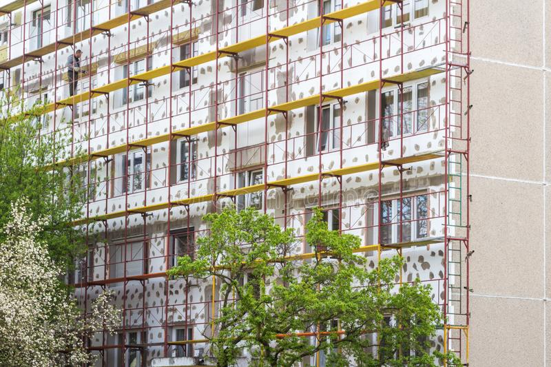 Tower block being insulated. With polystyrene, scaffolding royalty free stock image