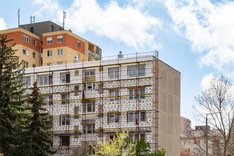 Tower block being insulated. With polystyrene in Hungary stock photos