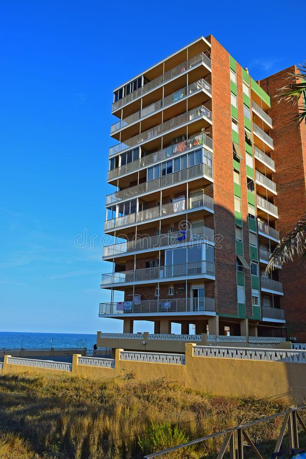 A Tower Block of Flats Beach With Blue Sky Background stock images