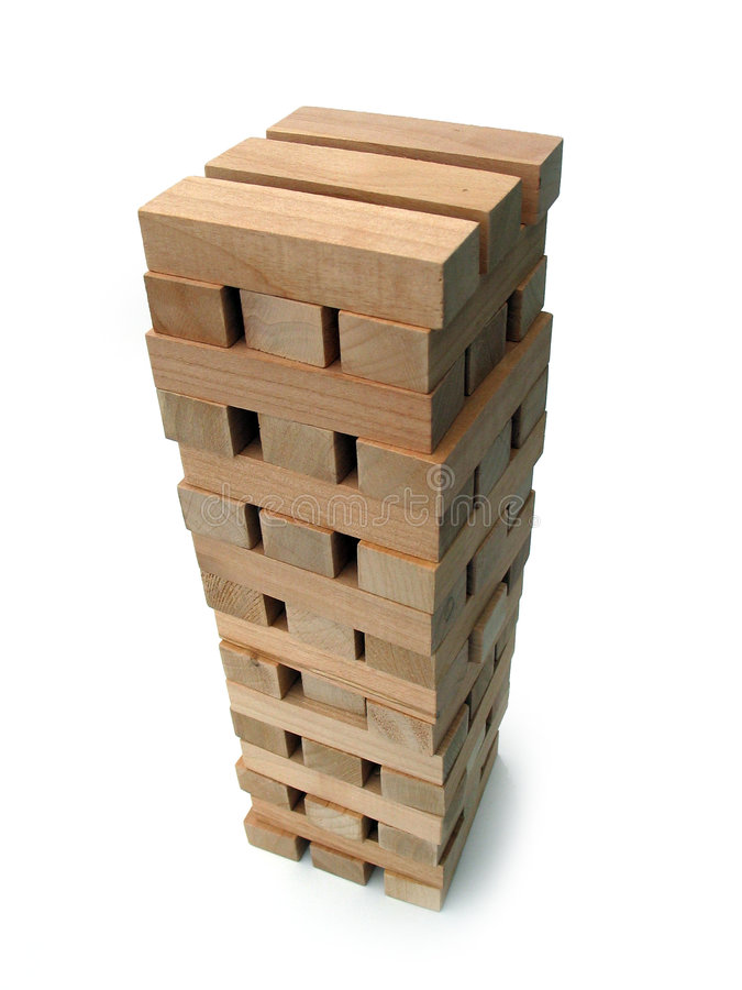 Tower of Blocks. Building blocks towering high, shows height, symbolic of stability, teamwork
