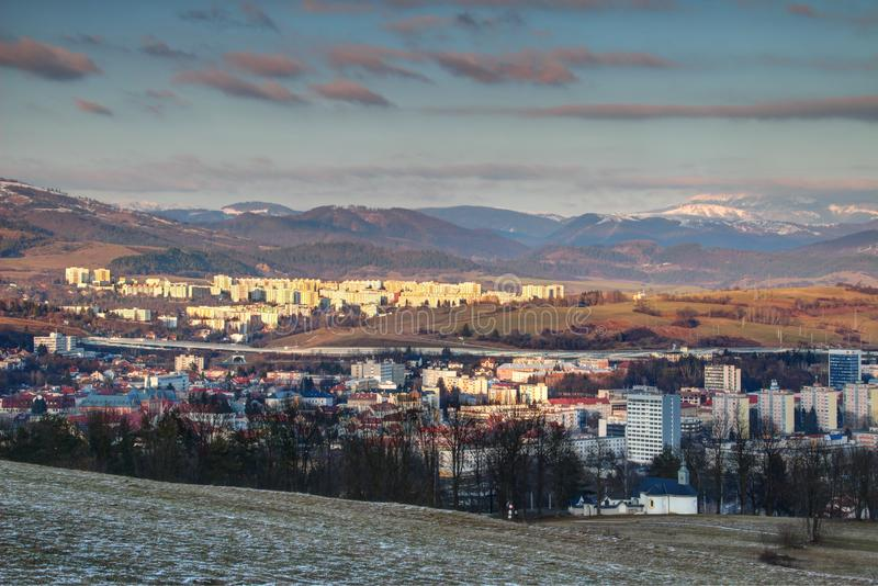 Tower blocks in Banska Bystrica and Low Tatra range in Slovakia. Elevated view of socialist era tower blocks and houses in outskirts of Banska Bystrica with snow stock photos