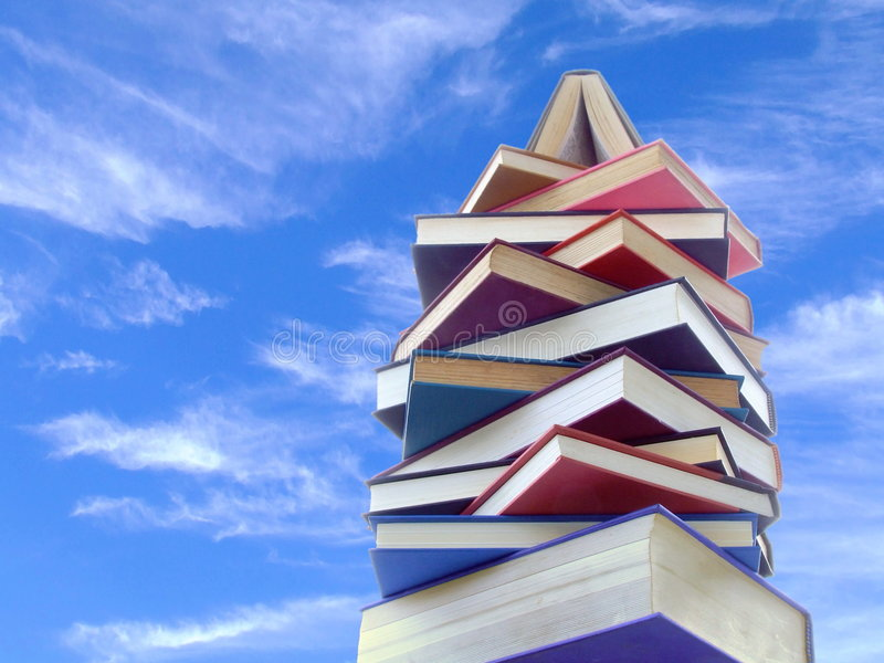Tower of Books. A tower made of books, seen against a bright sky royalty free stock photo