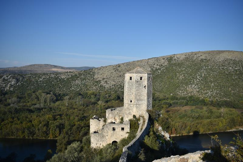 The Tower in the Bosnian medieval,oriental town of Počitelj and the Neretva river. The Tower in the Bosnian medieval town of Počitelj and the Neretva river royalty free stock images