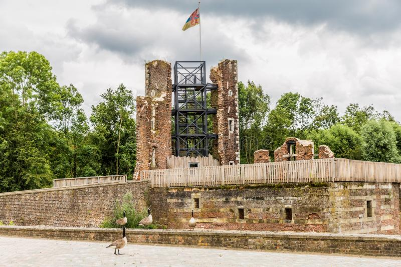 The tower and brick walls in ruins of castle Schaesberg. Wonderful and cloudy day in Landgraaf south Limburg in the Netherlands Holland stock photo