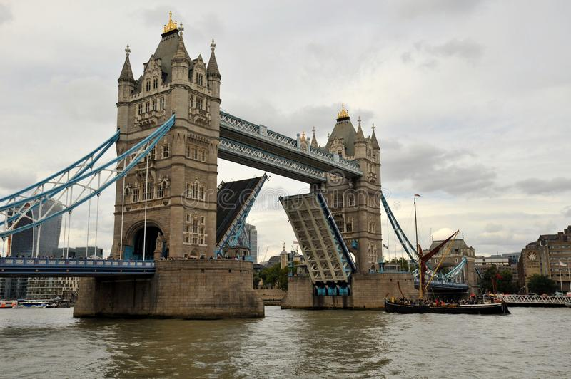 Tower Bridge is a combined bascule and suspension bridge in London that crosses Thames river stock photos