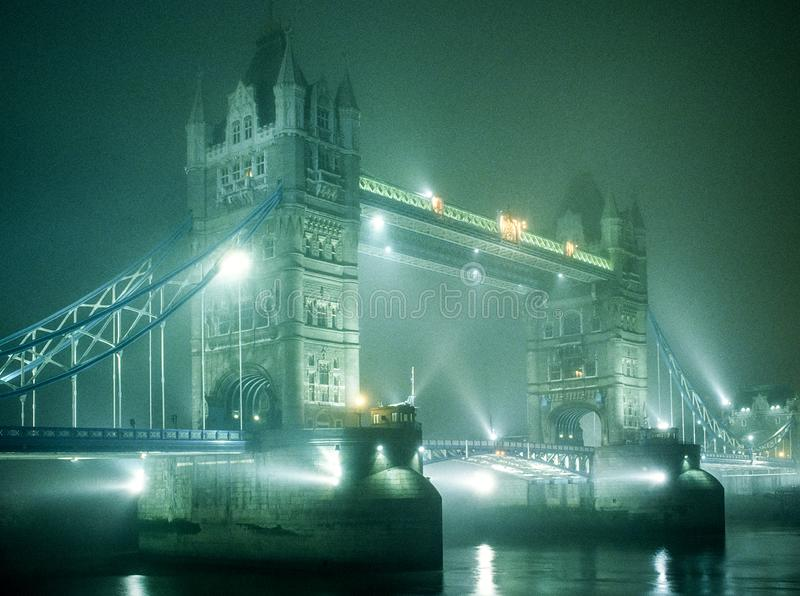 Tower Bridge in fog at night royalty free stock images