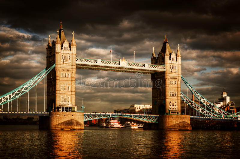 Tower Bridge in London, the UK. Dramatic stormy and rainy clouds royalty free stock image