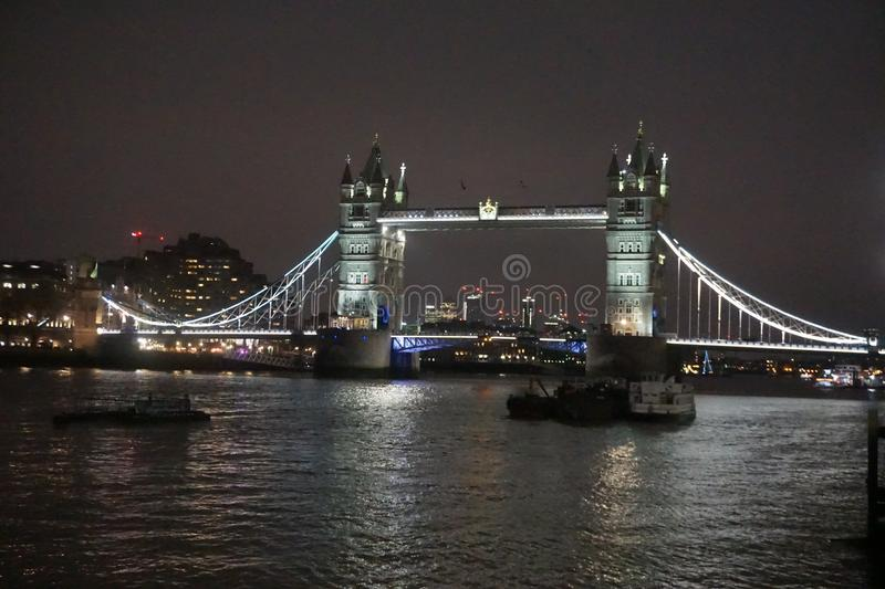 Tower Bridge at night showing the thames stock photos