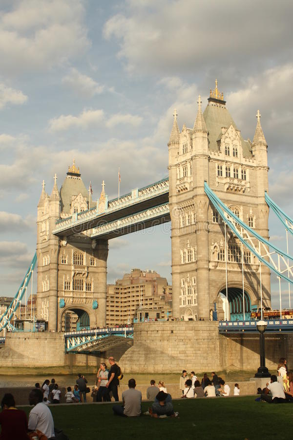 Tower Bridge. Oblique view of tourists visiting the combined bascule and suspension bridge - Tower Bridge built 1886–1894 in London royalty free stock image