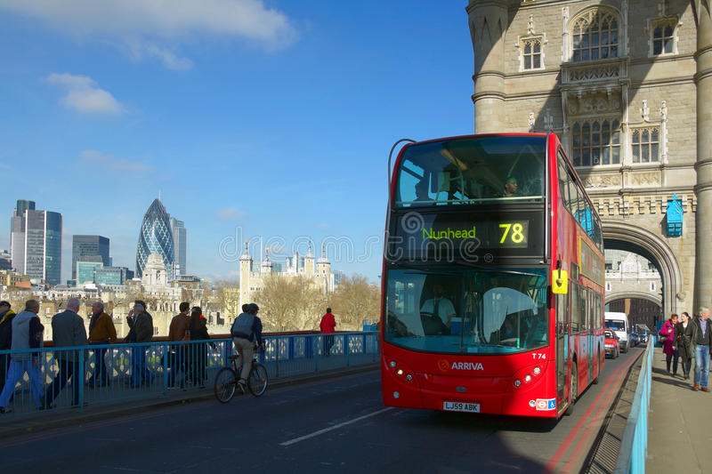 Tower Bridge perspective view with red bus, London royalty free stock image