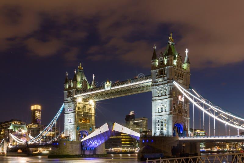 Tower Bridge raised to let ship pass through. London, England.  stock image