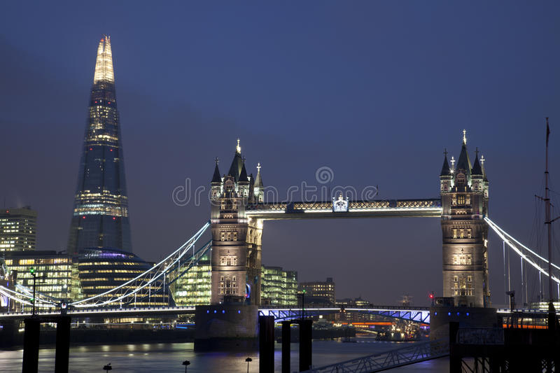Tower Bridge and The Shard in London at Night royalty free stock image