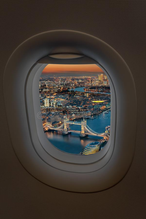 The Tower Bridge and skyline of London from an airplane window stock image