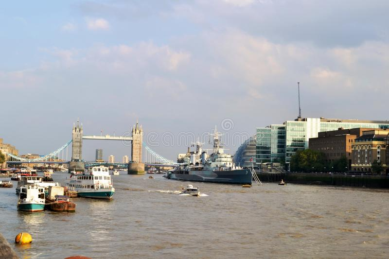 Tower bridge, Thames river, HMS Belfast in a sunny summer day. stock image