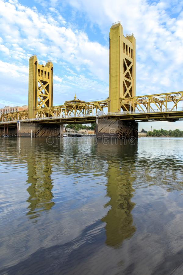 Tower Bridge with wispy sky reflected on the Sacramento River. royalty free stock image
