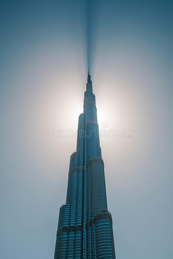 Tower Burj Khalifa cut the sky. Highest tower in the world touch the sky royalty free stock images